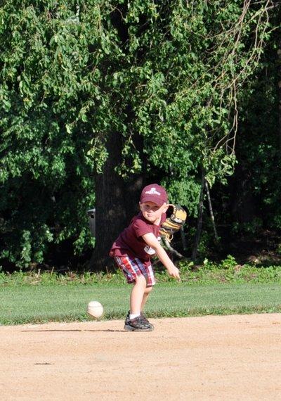 Jack playing baseball.