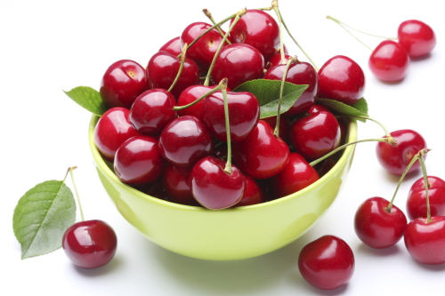 Bowl with ripe cherries.