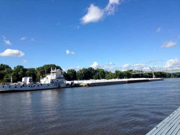 Tugboat and barges along the riverfront in Red Wing, MN