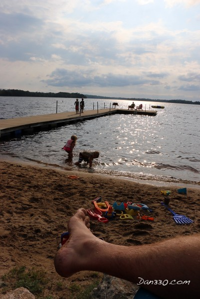 playing on the beach at elbow lake