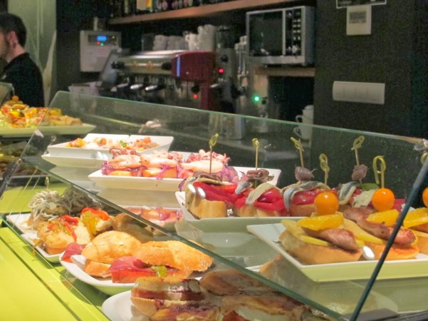 Pintxos or small plates of food, are featured at many restaurants.‏