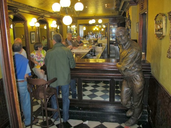 Ernest Hemingway often went to the Café Iruña in Pamplona, Spain. A full-size statue of him greets people at the bar.