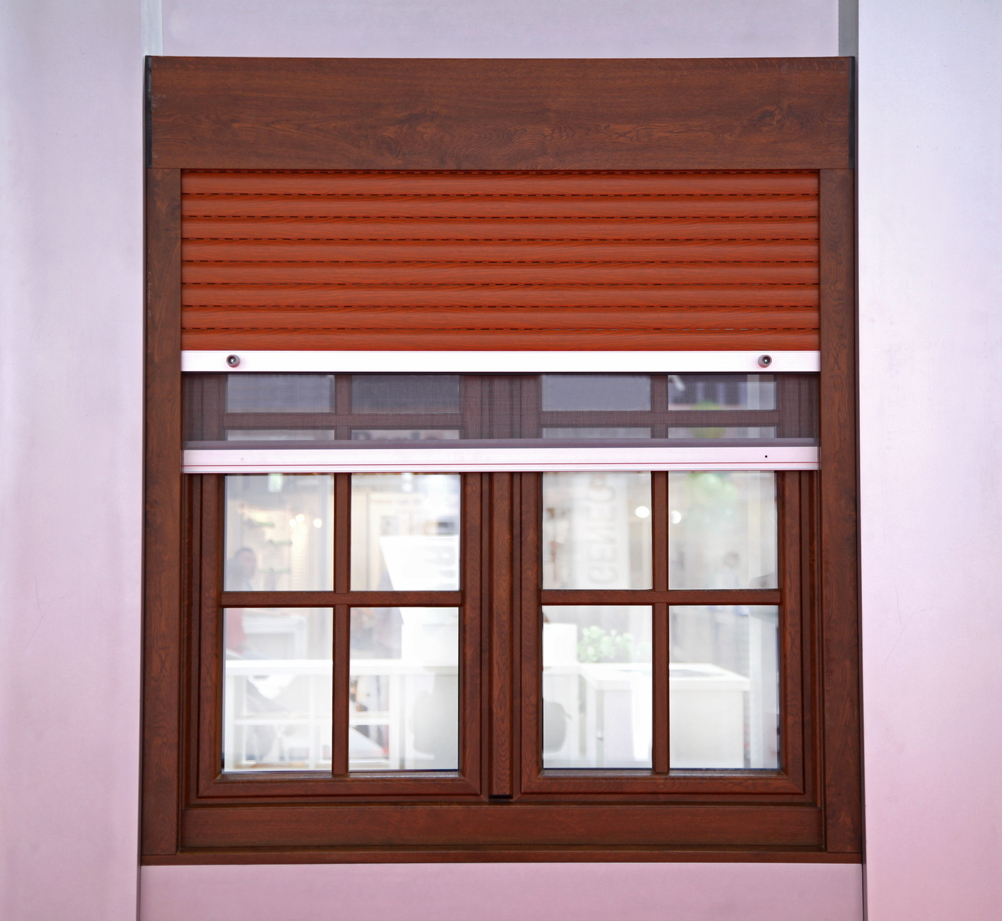 Closed window with brown blinds from outside