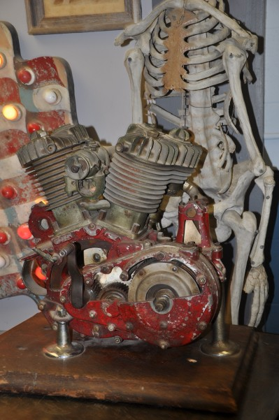 Old motorcycle motor with cut outs for display.