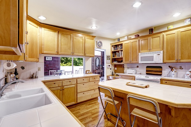 Kitchen room with wooden storage combination and kitchen island